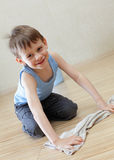 Child washing floor Royalty Free Stock Photo