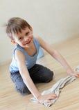 Child washing floor Royalty Free Stock Photo