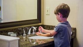 Child washing hands stock footage