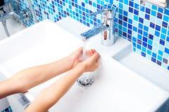 Child washing hands Stock Photos