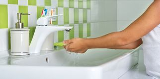 Child washing hands with soap in the bathroom. Protection against bacteria stock photos
