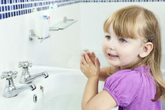 Child washing hands stock image