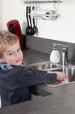 Child washing his hands Royalty Free Stock Photos