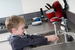 Child washing his hands Stock Images