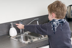Child washing his hands Royalty Free Stock Images