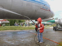 Child washing the plane. Little boy washing the plane at the air festival in Kyiv, Ukraine Royalty Free Stock Images