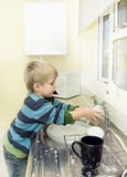 Child Washing taps. Royalty Free Stock Images