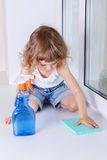 Child washing windows. Stock Photo