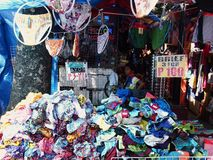 A child watches over his bazaar stall Royalty Free Stock Images