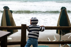Child watching bad weather at sea Royalty Free Stock Image
