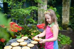 Child watching butterfly at tropical garden. Royalty Free Stock Photos