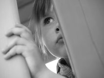 Child is watching over the fence Royalty Free Stock Photography