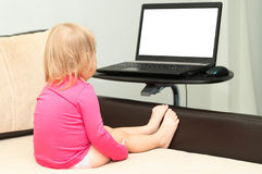 Child watching at screen Stock Images