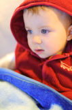 Child Watching TV. Baby in red hood watching TV Royalty Free Stock Images