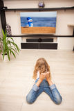Child watching TV Stock Images