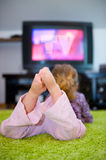 Child is watching TV Royalty Free Stock Images