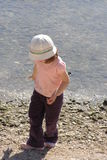 Child by water Stock Images