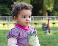Child with water bottle Stock Images