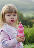 Child with water bottle in nature Stock Images