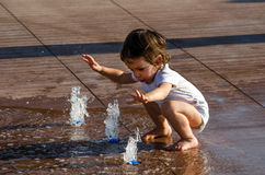 Child and water in the city Royalty Free Stock Photography