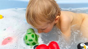 Child in water in foam Royalty Free Stock Images