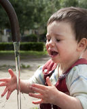 Child  in water fountain Stock Image