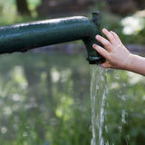 Child at water fountain Royalty Free Stock Photos
