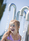 Child in a water fountain royalty free stock photo