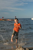 Child, water and fun. Beach fun. Stock Images