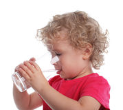 Child with a water glass Royalty Free Stock Photo