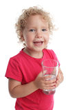 Child with a water glass Royalty Free Stock Image