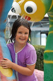 Child at water park. Little girl surrounded by cute water fountains at water park Royalty Free Stock Photography