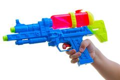 Child with a water pistol  on white Royalty Free Stock Image