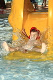 Child on water slide Royalty Free Stock Images