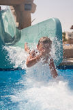 Child on Water Slide Royalty Free Stock Image