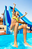 Child on water slide at aquapark. Child on water slide at aqua park. Summer holiday Stock Image