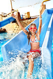 Child on water slide at aquapark. Summer holiday stock photography