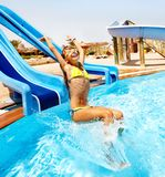 Child on water slide at aquapark. Royalty Free Stock Photography