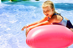 Child on water slide at aquapark. Royalty Free Stock Photo