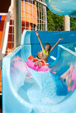 Child on water slide at aquapark Stock Photography