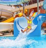 Child on water slide at aquapark Stock Image