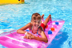 Child on water slide at aquapark Stock Image