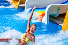 Child on water slide in aquapark. Royalty Free Stock Photography