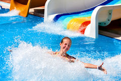 Child on water slide in aquapark. Stock Photography