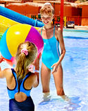 Child on water slide at aquapark. Royalty Free Stock Photos
