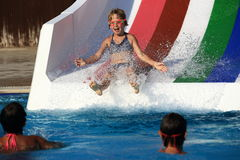 Child on water slide at aquapark. A picture of the child on water slide at aquapark stock photo