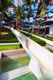 Child on water slide at aquapark Royalty Free Stock Photos