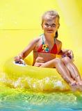 Child on water slide at aquapark. Summer holiday royalty free stock photo