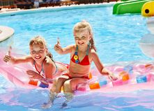 Child on water slide at aquapark. Summer holiday royalty free stock images