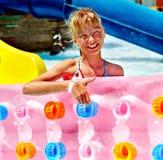 Child on water slide at aquapark. Summer holiday royalty free stock photos